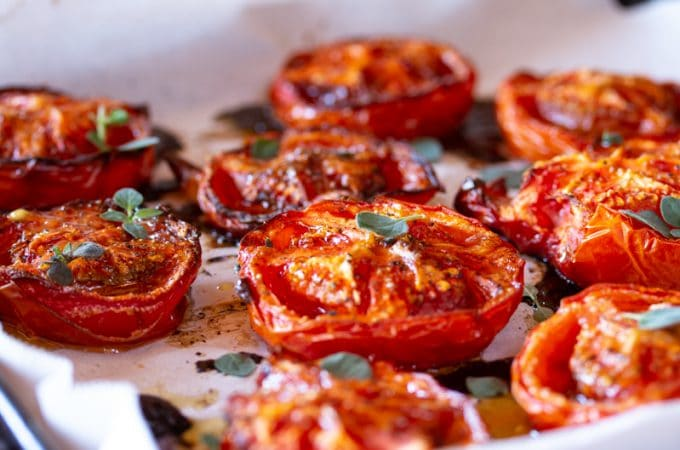 Balsamic roasted tomatoes are easy to make flavor-bombs of meaty umami flavor for vegetarian and vegan dishes. All you need are 5 ingredients + 5 minutes to prep them before roasting.