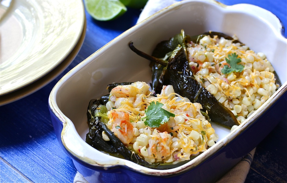 Roasted poblano peppers stuffed with warm corn salad
