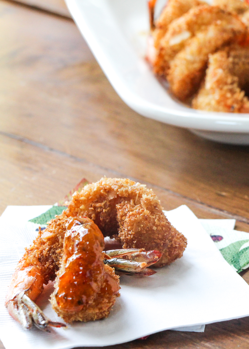 Crunchy coconut shrimp appetizer with a sweet and spicy dip of apricot preserves + pepper jelly.