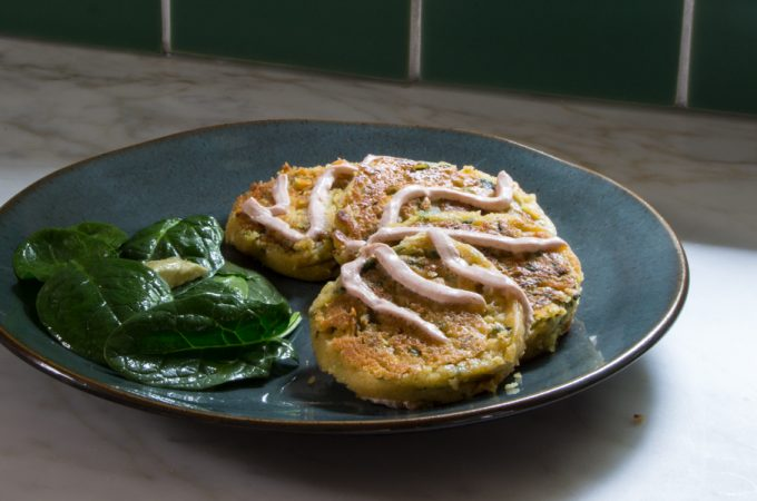 Chickpea pancakes filled with garlic, scallions and spinach, and topped with Sriracha Yogurt.