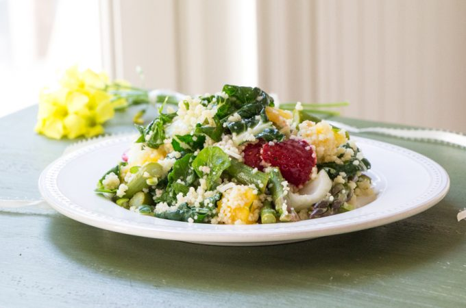 Baby bok choy couscous salad with mangoes and strawberries, dressed in a lemon garlic dressing.
