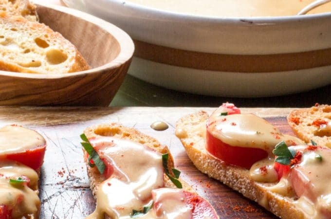 Welsh Rarebit sauce over toasts and tomatoes.