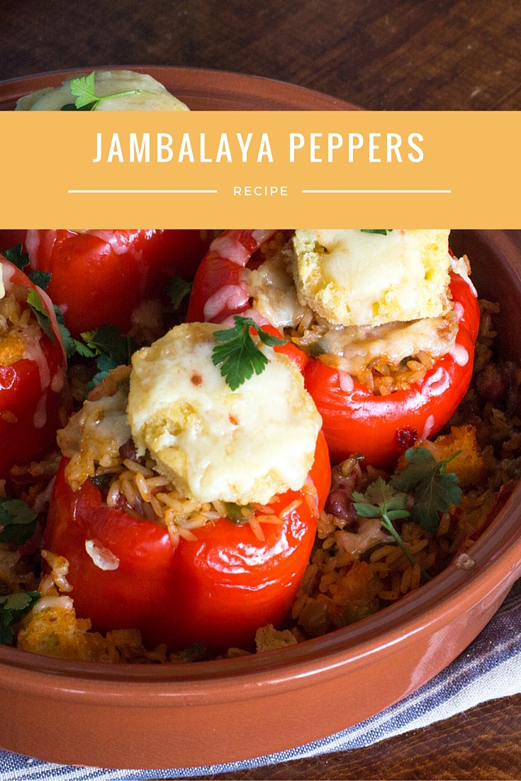 Jambalaya stuffed red peppers baked into a casserole, topped with cornbread and cheddar.