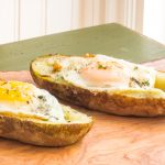 Lazy weekend breakfast of baked potato skins stuffed with cheese, avocado and an egg.