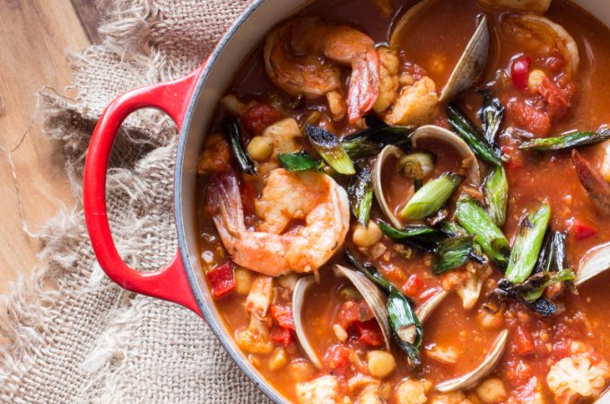 A sauce of prawns, clams, tomatoes and feta served over couscous.