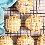 Pennsylvania Dutch spice drop cookies dotted with currents, drizzled with orange icing for Christmas.