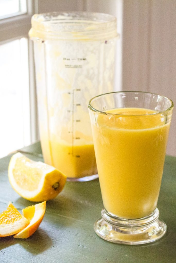 Orange mango smoothie with oranges, mango, ginger, and lime.