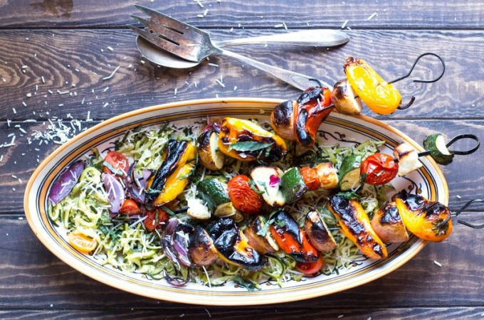 Skewers of potatoes, peppers, onions, zucchini, tomatoes, and halloumi over garlicky zoodles.