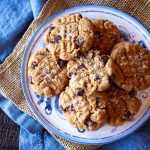 Easy Flourless Peanut Butter Cookies ready from start to finish in < 30 minutes. Gluten-free plus instructions for high altitude baking with a link to instructions for baking at sea level.