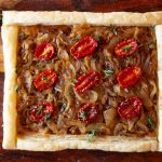 Step-by-step instructions for making a French onion tart with photos. Mushrooms and tomatoes are added for extra umami. This makes a perfect fall supper or party appetizer.