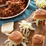Vegan Sloppy Joe Sliders using Beyond Beef ground 'meat' cooked in a sweet and tangy sauce, topped with vegan coleslaw. Perfect for any party!