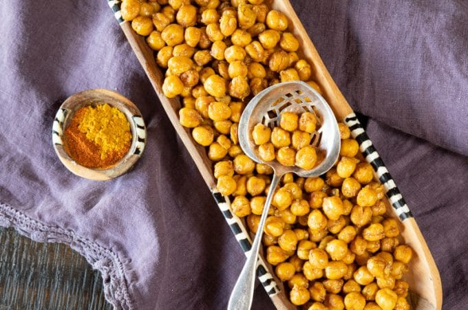 Curry and paprika roasted chickpeas for a healthy, delicious and easy snack.